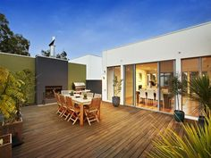 A modern take on a classic Australian BBQ area, complete with an outdoor fire place.
