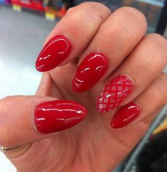 Red Nails! Almond shaped with a little bit of red fish nets. #nailart #rednails