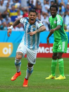FIFA World Cup 2014 - Argentina 3 Nigeria 2 (6.25.2014) Marcos Rojo of Argentina celebrates scoring his team's third goal during the 2014 FIFA World Cup Brazil Group F match between Nigeria and Argentina at Estadio Beira-Rio on June 25, 2014 in Porto Alegre, Brazil. Jeff Gross / Getty Images