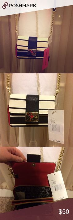 """NWT Betsey Johnson crossbody love letter  NWT Betsey Johnson mini cross body love letter purse. Has gold detachable strap with a strap drop of 24"""". Other measurements: 6 1/4"""" x 4"""" x 4"""". Purse has black & white stripes on the exterior & a red interior with Betsey's signature interior writing. 2 large open pockets on the inside & 3 small slots. Magnetic button closure with really cute gold love letter accent. Reasonable offers warmly welcomed  Betsey Johnson Bags Mini Bags"""