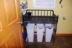 Repurpose changing table into a laundry station.