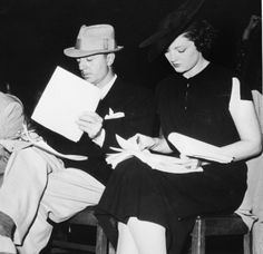 Myrna Loy and William Powell going over a script