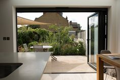Great use of bi-fold doors here to bring the garden into the home.  #garden #home #extension #kitchen #homeimprovement