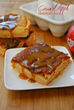 Caramel Apple Cheesecake Bars Recipe  2 cans crescent rolls 2 pkgs (8 oz) cream cheese, room temperature 1 cup plus 1/2 cup sugar 1 tsp vanilla extract 1 pkg Duncan Hines Apple Pie Recipe Creations 1 stick butter, melted 1 Tbsp cinnamon 1/2 cup caramel sundae sauce 1. Preheat oven to 350 degrees