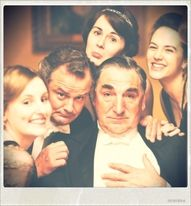 Cast of Downton Abbey making funny faces.