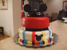 mickey mouse birthday cake. I like adding in the blue so it isn't just red yellow and black.
