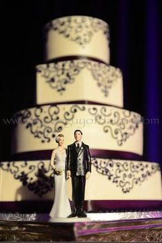 four tier wedding cake with purple ribbon with elegant detail