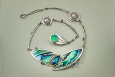 Necklace made from sterling silver, NZ Paua, swiss blue topaz, and fresh water pearls