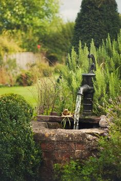 Old well pump water feature