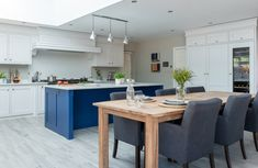 Striking bright blue island unit stands out against the pale units and flooring. We love the floor to ceiling cabinets which give so much storage space. Floor To Ceiling Cabinets, Belfast Sink, Stone Bathroom, Handmade Kitchens, Bespoke Kitchens, Larder, Kitchen Layout, Beautiful Kitchens, Storage Spaces