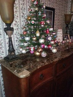 Feather tree with vintage ornaments