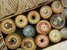 wooden spools  I still have these.. with thread on them. old, old.