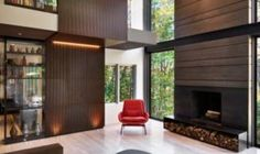 A modern renovation in Maryland soaks in surrounding forested views