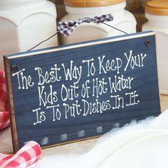 Keep Kids Out of Hot Water 6X9 Navy Sign.    Ever wonder why you're the only one who seems capable of washing even a single dish? Put a little humor into your dishwashing time with this cute painted sign perfect for hanging in your kitchen.