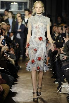 Embellishments are interesting. What are they? Little red devils?  Giles RTW Fall 2012 - London. Photo: Giovanni Giannoni.