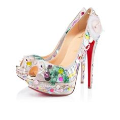 Louboutin shoes. I don't know what is going on with these but I like it.