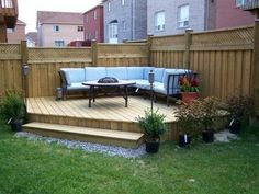 Idea for deck coming from the back door; anchor it to the sturdy corner fence and create walkway from door. (http://francotechnogap.com/)