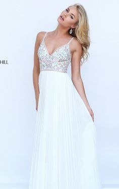 You cannot go unnoticed in Sherri Hill 50432. Revealing V-neckline supported with spaghetti straps leading the mid-open back. The entire top is gleamed with luxurious beads making you shine all night. This luxurious ensemble glides to the floor length hem in a picture perfect red carpet look.