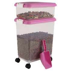 Set of 2 airtight stacking food containers on casters with a scoop.   Product: Small and large food container and scooper