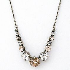 Sorrelli Snow Bunny Necklaces. Clear & champagne crystals create a delicate necklace to layer with other necklaces or wear solo. An understated bridal necklace as well.