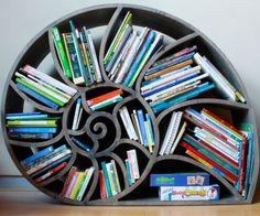 "instructables: ""Nautilus Bookshelf: ""This nautilus-inspired bookshelf isn't meant to be efficient or to pack books neatly, it's about willingly, enthusiastically accepting the chaos that is kids books."" - ewilhelm http://ift.tt/1HqPHvu """