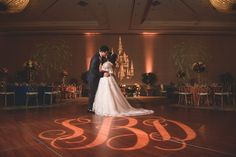 Disney Fairy Tale Wedding bride and groom get a sneak peek at their reception in the Grand Floridian's St Augustine Ballroom