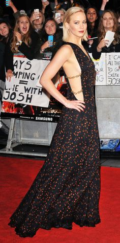 Jennifer Lawrence struck a pose at the UK premiere of The Hunger Games: Mockingjay, Part 2 in another one of her flawless looks, courtesy of a printed chiffon-and-silk Dior gown with racy cut-out panels on each side. She accessorized with Zoe Chicco gold bar earrings and a diamond Djula hand chain.