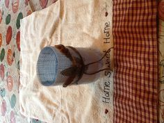Water bottle tea light - cover with burlap, burlap flowers with wire and twine. Really pretty with a blue tinted bottle.