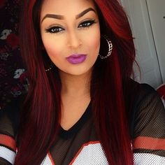This girl is beautiful, love her makeup and the color of her hair..