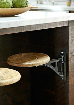 Stools can be bulky things that there just isn't quite enough space for. So consider a seat that slides away under your kitchen island. #LoveYourHome