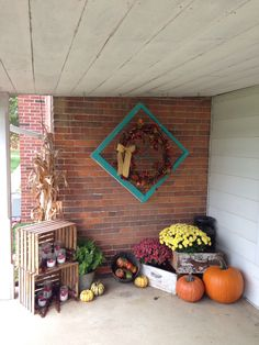Fall decorations for a small porch. All you need are some crates, ball jars, old window, two old dresser drawers, wreath and some fall pumpkins and decor.