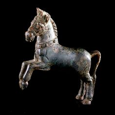 "Roman Bronze Sculpture of a Horse - X.0023          Origin: Mediterranean          Circa: 2 nd Century AD to 3 rd Century AD           Dimensions: 4.875"" (12.4cm) high x 5.125"" (13.0cm) wide           Collection: Classical          Style: Roman          Medium: Bronze"