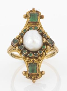An antique emerald and cultured pearl ring, circa 1890  cultured pearl measuring approximately: 8.9 x 8.0mm; mounted in eighteen karat gold;