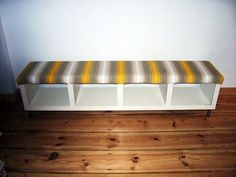 Bookcase turned upholstered bench. I like this idea for our mudroom.