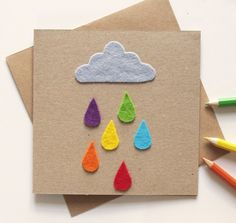 A handmade felt raindrop and cloud birthday or other greeting card for that special little person in your life. Any child will love this colourful gift card; also perfectly suitable for fun loving big kids! This cheerful kids card is blank inside for your own message. The outside of the