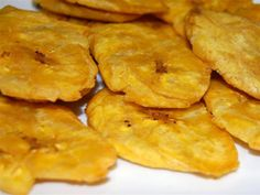 Here's a simple recipe for making tostones, twice fried flattened green plantains as it's done in Puerto Rico, Dominican Republic, Latin America and the. Banane Plantain, Fried Plantain, Peruvian Recipes, Mexican Food Recipes, Honduran Recipes, Peruvian Cuisine, Baked Plantains, Comida Boricua, Sweets