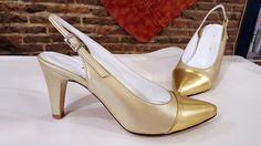 Modelo en punta, está hecho en champán y oro.