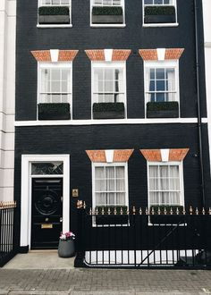 a dark grey exterior row house in London | 48 hour travel guide via coco kelley