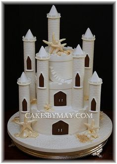 Sand Castle Wedding Cake this is a cake? I could never eat it ....