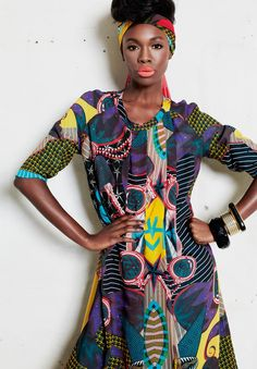 Vlisco Funky Grooves Fashion Look  Her dress is made from the same fabric used in the scarf.