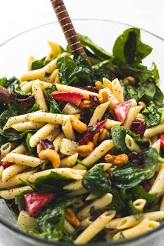 Sweet and tangy strawberry spinach pasta salad with orange poppyseed dressing with pineapple, cashews, and tart cranberries is the perfect potluck side dish for every get together. I'm admitting it