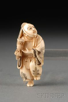 Ivory Netsuke, 19th century, figure of a dancer holding a drum, signed Yoshitami, ht. 2 1/2 in.