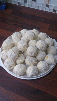 Carrot cake balls coated in white chocolate and coconut