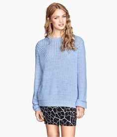 Liven up this light blue sweater with a short skirt in a black & white geometric pattern.│ H&M Divided