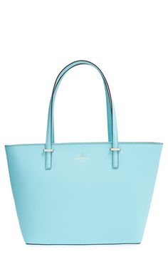 This sleek Kate Spade mint tote is perfect for a work bag! It's classy, sturdy, professional and fits all the 9-to-5 essentials like a laptop, notebook, iPhone and papers. This bag is perfection <3
