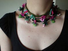 This is a crochet necklace made from quality cotton and acrylic fibers and delica beads, with freeform crochet techniques.    The necklace