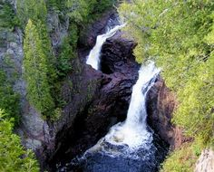 There is a mysterious waterfall in Judge Magney State Park in Minnesota. Half of the water drops 50 feet into the Brule river; the other half falls into a cauldron and disappears.