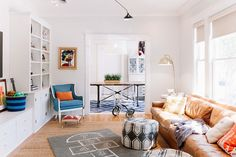Excel at Extra Seating: Living Rooms With Perfect Pouf Placement — Rooms That Get It Right | Apartment Therapy