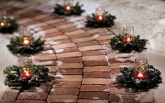 Christmas Party Decorating idea,small wreath, mason jar, either sand or rock salt, with votive candle. Or another way with water and christmas greenery with cranberries, and a floating white candle.