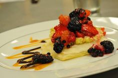 Mixed berries on Phyllo with Honey Pistachio Marscapone. salted caramel and buckwheat honey ganache